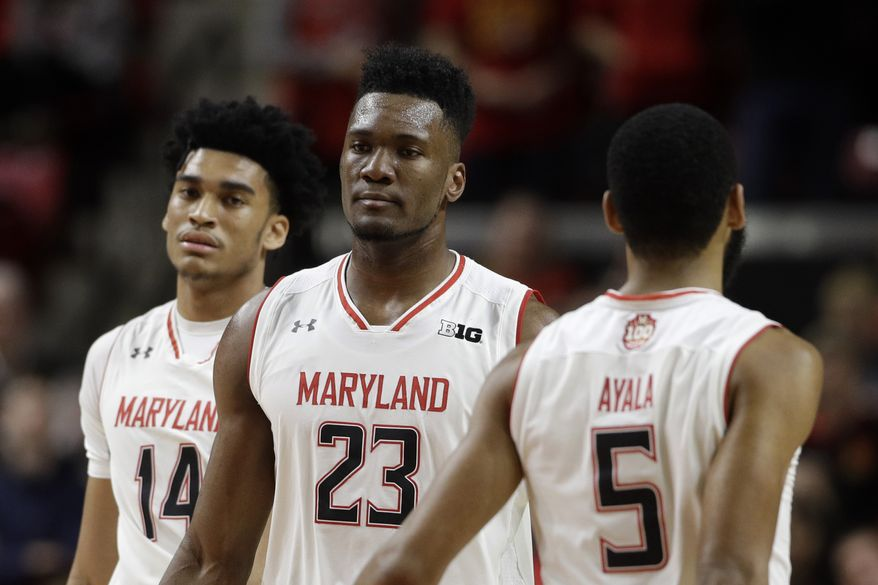 Maryland forward Bruno Fernando, of Angola, (23) walks past teammates Ricky Lindo Jr., back left, and Eric Ayala in the first half of an NCAA college basketball game against Purdue, Tuesday, Feb. 12, 2019, in College Park, Md. (AP Photo/Patrick Semansky) ** FILE **