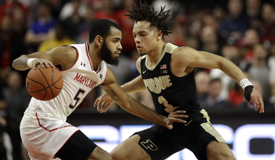 Maryland guard Eric Ayala, left, drives against Purdue guard Carsen Edwards during the first half of an NCAA college basketball game Tuesday, Feb. 12, 2019, in College Park, Md. (AP Photo/Patrick Semansky)
