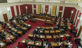 In this Monday, Feb. 11, 2019, photo, delegates, teachers and school personnel attend a public hearing on education in the House of Delegates chamber in Charleston, W.Va. (Craig Hudson/Charleston Gazette-Mail via AP)