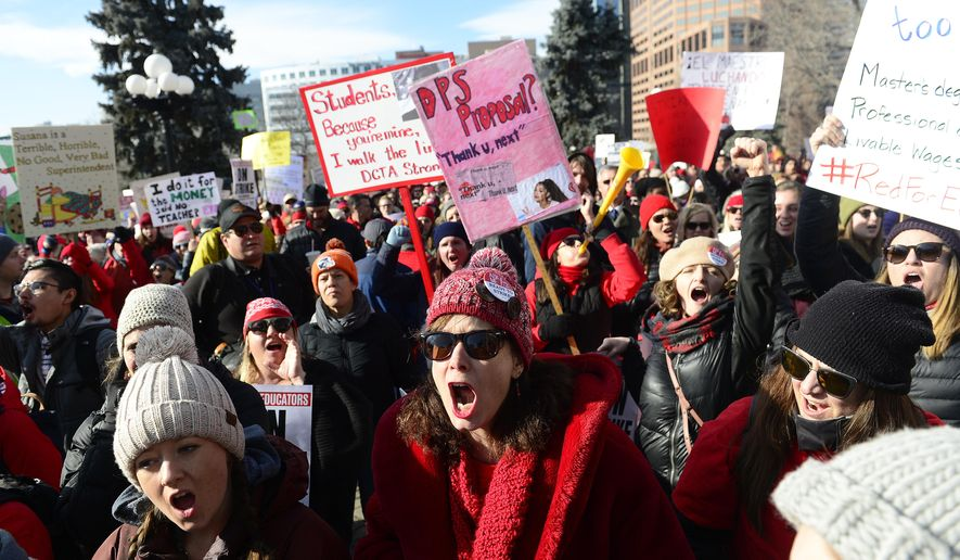 Lori Gates, center, a 3rd grade teacher from Park Hill elementary school, shouts with other teachers during a strike rally on the west steps of the state Capitol on the first day of the Denver Public Schools Teacher's strike, Monday, Feb. 11, 2019, in Denver. More negotiations are set for Tuesday. (Helen H. Richardson/The Denver Post via AP)
