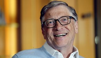 In this Feb. 1, 2019, file photo, Bill Gates smiles while being interviewed in Kirkland, Wash. (AP Photo/Elaine Thompson) ** FILE **
