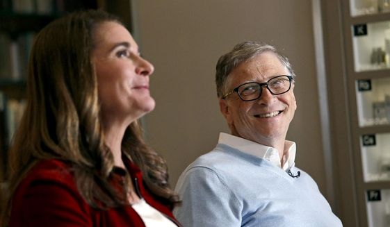 In this Feb. 1, 2019, photo, Bill Gates looks to his wife Melinda as they are interviewed in Kirkland, Wash. (AP Photo/Elaine Thompson) ** FILE **