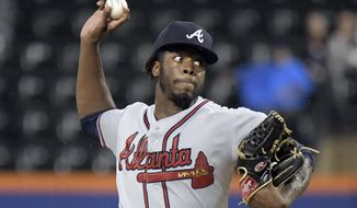 FILE - In this Sept. 25, 2018, file photo, Atlanta Braves pitcher Touki Toussaint delivers the ball to a New York Mets batter during the first inning of a baseball game, in New York. There is room for at least one young pitcher to emerge in Atlanta's rotation as the Braves pitchers and catchers prepare to report to spring training this week. Touki Toussaint and Mike Soroka are two names to watch. (AP Photo/Bill Kostroun, File)