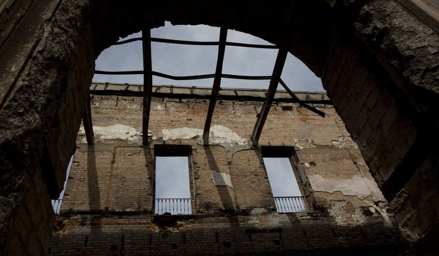 The ruins of Brazil's National Museum stand, in Rio de Janeiro, Brazil, Tuesday, Feb. 12, 2019. Five months after a devastating fire engulfed Brazil's National Museum, the facility is still in dire straits and efforts to rebuild slow-moving. (AP Photo/Silvia Izquierdo)