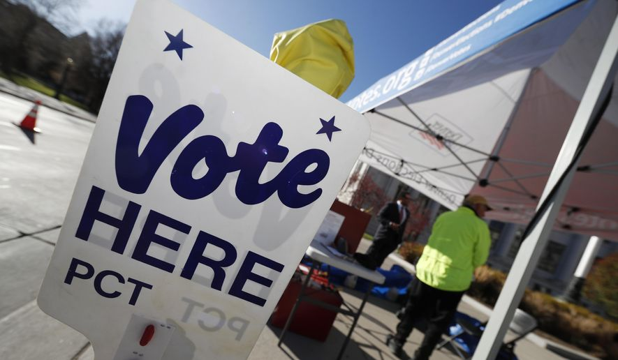 In this Nov. 6, 2018, file photo a sign directs voters to the Denver Elections Division drop off location in front of the City/County Building in Denver. Colorado's Democrat-controlled Legislature is rushing a bill to have the state join others in casting its electoral votes for the winner of the national popular vote. (AP Photo/David Zalubowski, File)