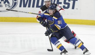 St. Louis Blues' Vladimir Tarasenko (91) skates past New Jersey Devils' Damon Severson (28) wit the puck in the third period of an NHL hockey game, Tuesday, Feb. 12, 2019, in St. Louis. The Blues beat the Devils 8-3. (AP Photo/Tom Gannam)