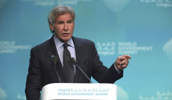 "American actor Harrison Ford speaks about ocean conservation at the World Government Summit in Dubai, United Arab Emirates, Tuesday, Feb. 12, 2019. Ford offered an emphatic plea for protecting the world's oceans while calling out U.S. President Donald Trump and others who ""deny or denigrate science."" (AP Photo/Jon Gambrell)"