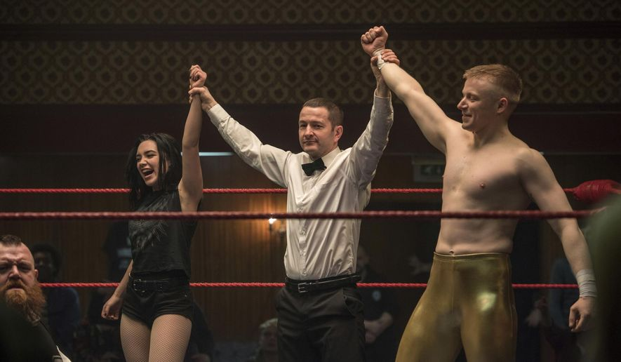 """This image released by Metro Goldwyn Mayer Pictures shows Florence Pugh, left, and  Jack Lowden, right, in a scene from """"Fighting with My Family."""" (Robert Viglasky/Metro Goldwyn Mayer Pictures via AP)"""