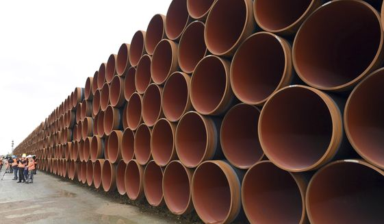 FILE - In this May 8, 2017 photo steel pipes for the North Stream 2 pipeline are stacked in Mukran harbour in Sassnitz, Germany. (Stefan Sauer/dpa via AP, file)