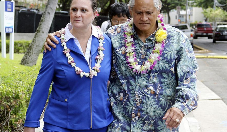FILE - In this Oct. 20, 2017, file photo, former Honolulu Police Chief Louis Kealoha, right, and his wife, Katherine Keahola, leave federal court in Honolulu. A federal grand jury has indicted Tuesday, Feb. 12, 2019, former Honolulu prosecutor Katherine Keahola and her brother on drug distribution charges. (AP Photo/Caleb Jones, File)