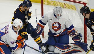 Buffalo Sabres forward Jason Pominville (29) is stopped by New York Islanders goalie Robin Lehner (40) during the first period of an NHL hockey game, Tuesday, Feb. 12, 2019, in Buffalo N.Y. (AP Photo/Jeffrey T. Barnes)