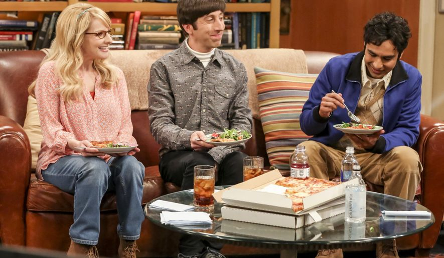 """This photo provided by CBS shows Melissa Rauch, from left, Simon Helberg and Kunal Nayyar in a scene from """"The Big Bang Theory."""" As the time approaches to say goodbye to Sheldon, Amy, Leonard, Penny and the gang, the CBS comedy """"The Big Bang Theory"""" hit a season high in popularity. The Nielsen company said Tuesday that television's most popular comedy was watched by 14.2 million people last week. (Michael Yarish/Warner Bros. Entertainment Inc./CBS via AP)"""