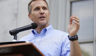 FILE - In this May 23, 2017, file photo, Missouri Gov. Eric Greitens speaks to supporters during a rally outside the state Capitol in Jefferson City, Mo. Greitens resigned June 1, 2018, while facing potential House impeachment proceedings over allegations of sexual and political misconduct. A woman with whom Greitens had an extramarital affair testified that he slapped, shoved, restrained and belittled her during a series of sexual encounters in 2015, while he was preparing to run for governor.  (AP Photo/Jeff Roberson, File)