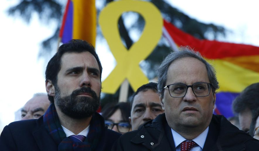 Catalan regional President Quim Torra, right, and the president of Catalonian Parliament Roger Torrent arrive at the Spanish Supreme Court in Madrid, Tuesday, Feb. 12, 2019. Spain is bracing for the nation's most sensitive trial in four decades of democracy this week, with a dozen Catalan separatists facing charges including rebellion over a failed secession bid in 2017. (AP Photo/Andrea Comas)
