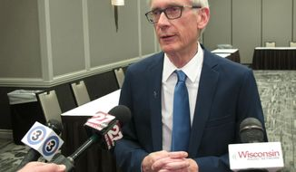 Wisconsin Gov. Tony Evers voices opposition to a Republican-authored income tax cut bill, saying he favors his plan which would all-but eliminate a manufacturing tax credit, Tuesday, Feb. 12, 2019, in Madison, Wis. (AP Photo/Scott Bauer)