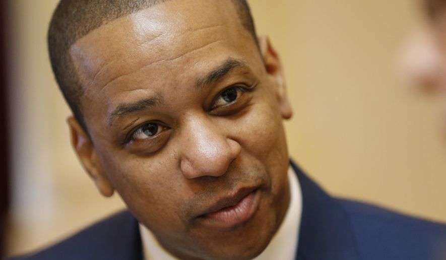 Virginia Lt. Gov. Justin Fairfax is prepped for the Senate session at the Capitol in Richmond, Va., Tuesday, Feb. 12, 2019. Vanessa Tyson, a college professor who has accused Fairfax of sexual assault, will appear Tuesday at a long-planned Stanford University academic symposium on that topic. (AP Photo/Steve Helber)