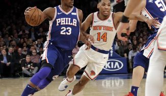 Philadelphia 76ers' Jimmy Butler (23) drives past New York Knicks' Allonzo Trier (14) during the first half of an NBA basketball game, Wednesday, Feb. 13, 2019, in New York. (AP Photo/Frank Franklin II)