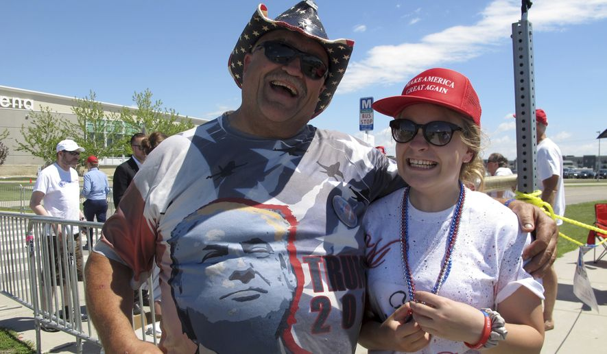 Randal Thom, left, of Lakefield, Minn., and Kindra Viktora of Minneapolis were among the first dozen or so people in line to wait and see President Donald Trump speak at Scheels Arena in Fargo, N.D., on Wednesday, June 27, 2018. Thom, who raises Alaskan malamutes for a living, said the Fargo event is the 34th Trump rally he has attended. He showed up at the building at 8:30 p.m. the night before. (AP Photo/Dave Kolpack)