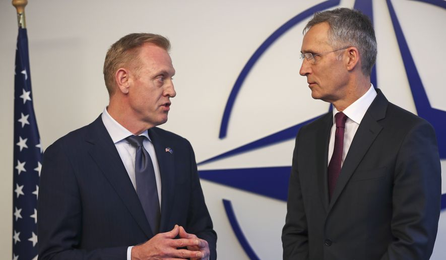 Acting U.S. Defense Secretary Patrick Shanahan, left, talks to NATO's Secretary General Jens Stoltenberg for the media during a meeting of NATO defense ministers at NATO headquarters in Brussels, Wednesday, Feb. 13, 2019. (AP Photo/Francisco Seco)