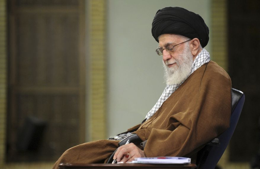 In this picture released on Jan. 12, 2019, by the official website of the office of the Iranian supreme leader, Supreme Leader Ayatollah Ali Khamenei takes notes during a meeting in Tehran, Iran.  (Office of the Iranian Supreme Leader via AP)