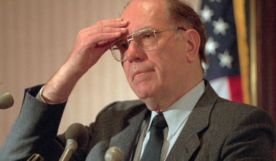 In this Feb. 3, 1994, file photo, Lyndon LaRouche gestures during a news conference in Arlington, Va.. (AP Photo/Joe Marquette, File)
