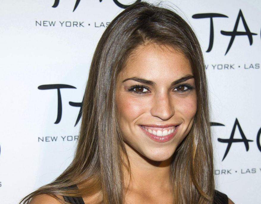 """FILE - In this Oct. 16, 2010, file photo, Antonella Barba arrives to the 10th Anniversary of TAO restaurant in New York. A recently unsealed court document says the former contestant on both """"American Idol"""" and """"Fear Factor"""" worked as a courier for a drug ring and was trying to deliver nearly 2 pounds (830 grams) of fentanyl when she was arrested last year. The Virginian-Pilot reports Barba was back in custody Monday, Feb. 11, 2019, following a federal indictment charging her with conspiracy to distribute cocaine, heroin and fentanyl. Barba was originally arrested last October in Norfolk. (AP Photo/Charles Sykes, File)"""
