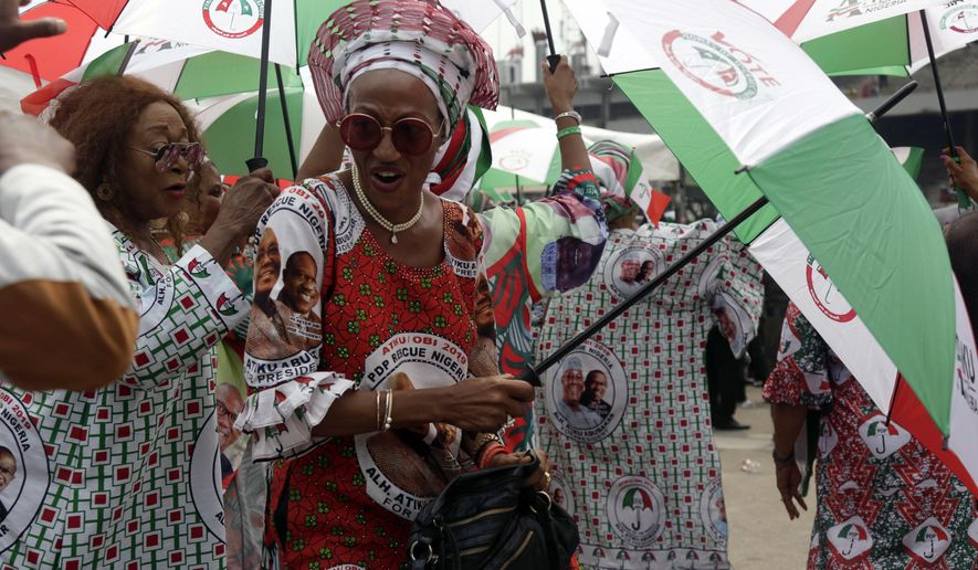 A supporter of Nigerian presidential candidate Atiku Abubakar, of the People's Democratic Party, attends an election campaign rally at the Tafawa Balewa Square, in Lagos, Nigeria, Tuesday, Feb. 12, 2019. Nigeria goes to the polls on Saturday to elect a new president. (AP Photo/Sunday Alamba)