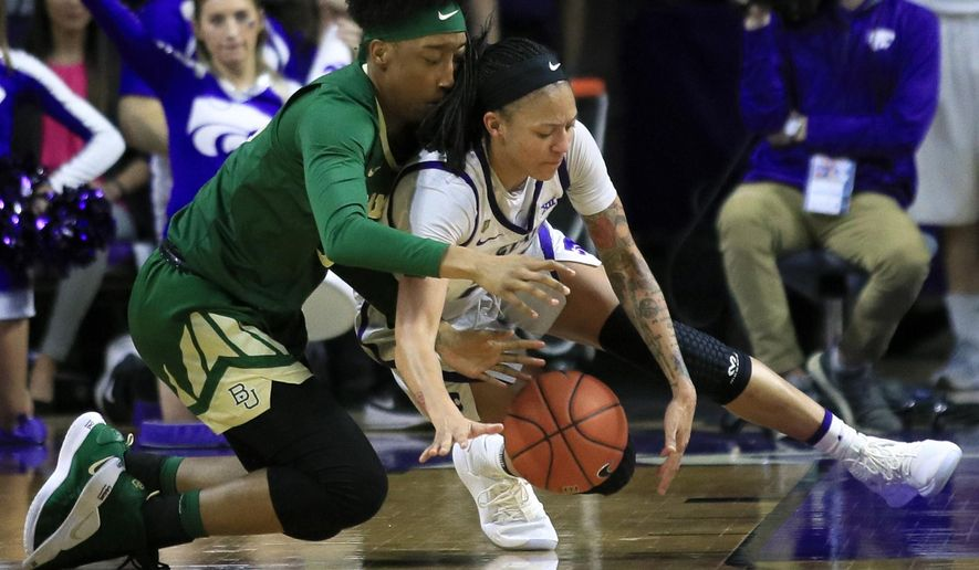 Baylor forward Aquira DeCosta, left, and Kansas State forward Jasauen Beard, right, dive for a loose ball during the second half of an NCAA college basketball game in Manhattan, Kan., Wednesday, Feb. 13, 2019. Baylor defeated Kansas State 71-48. (AP Photo/Orlin Wagner)