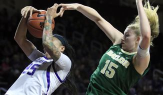 Baylor forward Lauren Cox (15) blocks a shot by Kansas State forward Jasauen Beard (25) during the first half of an NCAA college basketball game in Manhattan, Kan., Wednesday, Feb. 13, 2019. (AP Photo/Orlin Wagner)