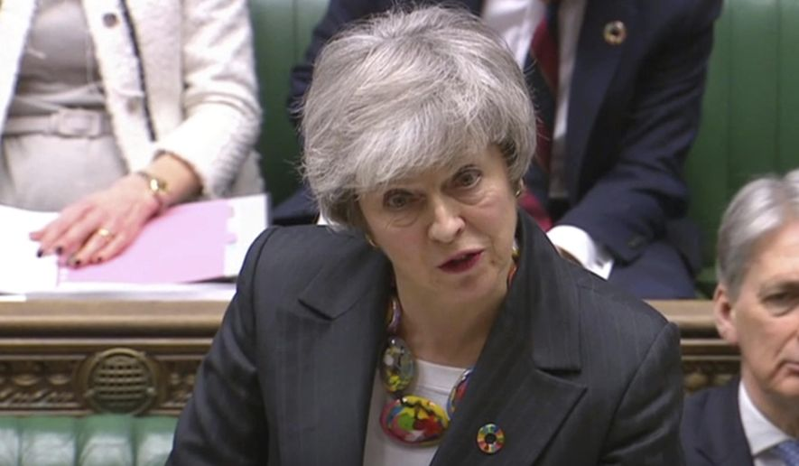 """In this image taken from video, Britain's Prime Minister Theresa May gives a statement about progress on Brexit talks to members of parliament in the the House of Commons, London, Tuesday Feb. 12, 2019. Theresa May was urging restive lawmakers Tuesday to """"hold their nerve"""" and give her more time to rework a divorce agreement with the European Union. (House of Commons/PA via AP)"""