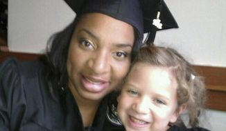 This undated selfie shows Amberkatherine DeCory with her daughter, Mila DeCory. Until her daughter could speak, Decory, a police officer who lives outside Minneapolis, carried her birth certificate and even a photo of her giving birth, just in case the African-American and Native American had to prove that her light-haired, blue-eyed child was truly her own. Families like theirs were not surprised when they heard that Cindy McCain reported a woman to police for possible human trafficking because McCain saw her at the airport with a toddler of a different ethnicity. (Amberkatherine DeCory via AP)