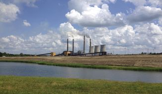 This June 3, 2014, file photo shows a panoramic view of the Paradise Fossil Plant in Drakesboro Ky. (AP Photo/Dylan Lovan, File)