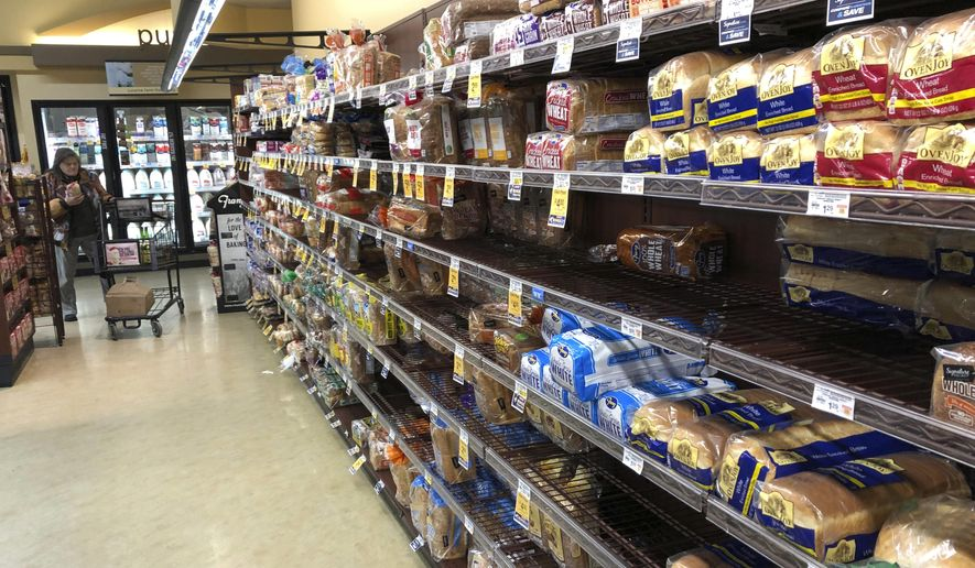 This Feb. 7, 2019, file photo shows the bread section of a Safeway store in Tacoma, Wash. On Wednesday, Feb. 13, 2019, the Labor Department reports on U.S. consumer prices for January. (AP Photo/Ted S. Warren, File)