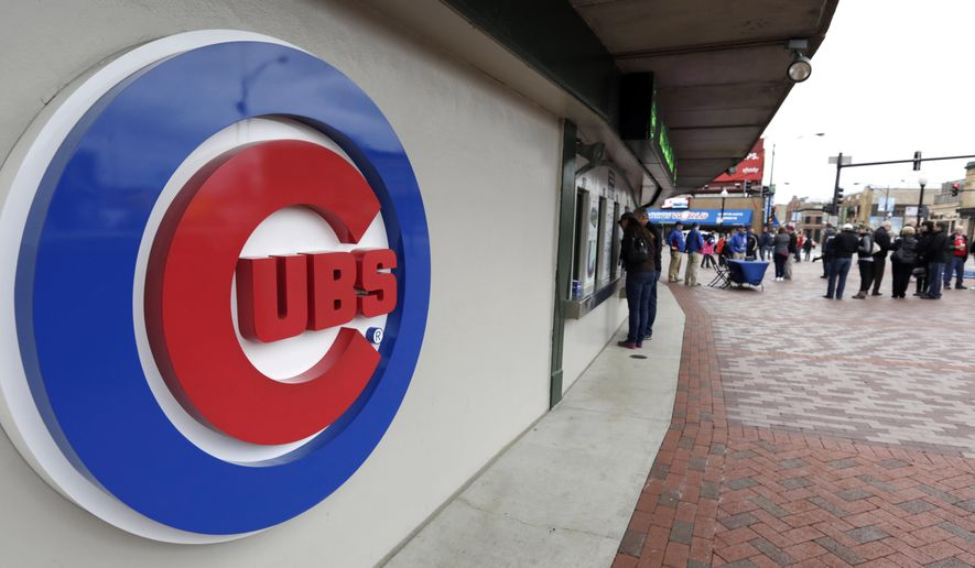 FILE - This April 15, 2013, file photo shows the Chicago Cubs logo on the exterior of Wrigley Field, in Chicago. The Chicago Cubs and Sinclair Broadcast Group are launching a regional sports network in 2020 that will be the team's exclusive TV home. The Cubs said Wednesday, Feb. 13, 2019, the Marquee Sports Network will carry live game broadcasts and pregame and postgame coverage. (AP Photo/M. Spencer Green, File)