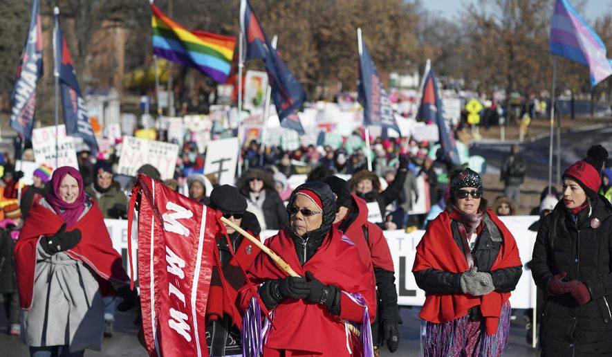 FILE - In this Jan. 19, 2019 file photo Rene Ann Goodrich, of Superior with Missing and Murdered Indigenous Women, leads the procession though the streets of St. Paul during the Women's March at the State Capitol in St. Paul, Minn. Lawmakers in at least seven states have introduced legislation to address the unsolved deaths and disappearances of numerous Native American women and girls. (Anthony Souffle/Star Tribune via AP, file)
