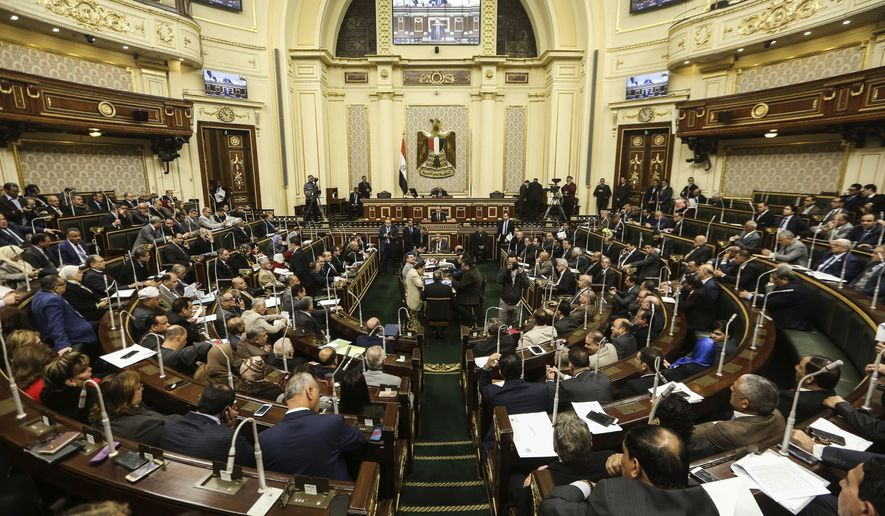 Egypt's Parliament meets to deliberate over constitutional amendments that could allow President Abdel-Fattah el-Sissi to stay in office till 2034, in Cairo Egypt, Wednesday, Feb 13, 2019. Wednesday's session will lead to a vote later in the evening or on Thursday, after which the text of the amendments would be finalized by a special committee for a final decision within two months. El-Sissi's current second term expires in 2022. (AP Photo)