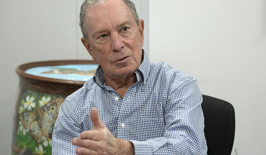 """FILE - In this Feb. 8, 2019, photo, former New York City Mayor Michael Bloomberg answers an question during an interview with The Associated Press in Orlando, Fla. Bloomberg measures his progress on climate change in metric tons. His political party, it seems, prefers big ideas. Many Democratic presidential contenders embraced the """"Green New Deal"""" immediately after it was released last week. (AP Photo/Phelan M. Ebenhack)"""