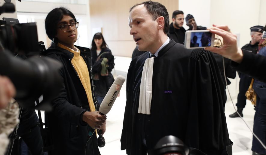 Plaintiffs' lawyer Jean-Philippe Morel answers media at the Paris' courthouse, ahead of the opening hearing of Christophe Dettinger's trial, in Paris, Wednesday, Feb. 13, 2019. A former boxing pro and suspected of viciously attacking riot police officers with his fists and feet during the yellow vest protests in France is going on trial on charges. (AP Photo/Thibault Camus)