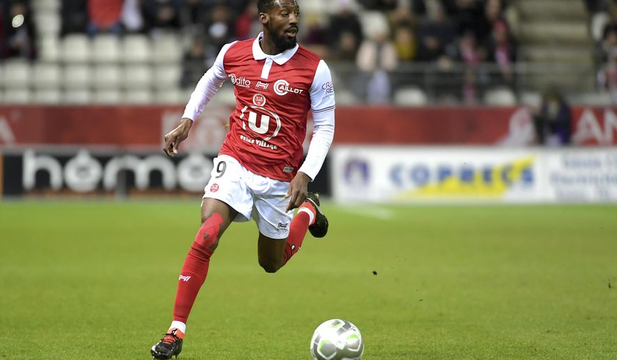 "FILE - In this March 9, 2018, file photo, Reims' Anatole Ngamukol controls the ball during a league II soccer match against Chateauroux in Reims, eastern France. French soccer players are turning to the courts to fight workplace bullying and the practice known in France by an English word, ""le loft."" (AP Photo/Christian Lantenois, File)"