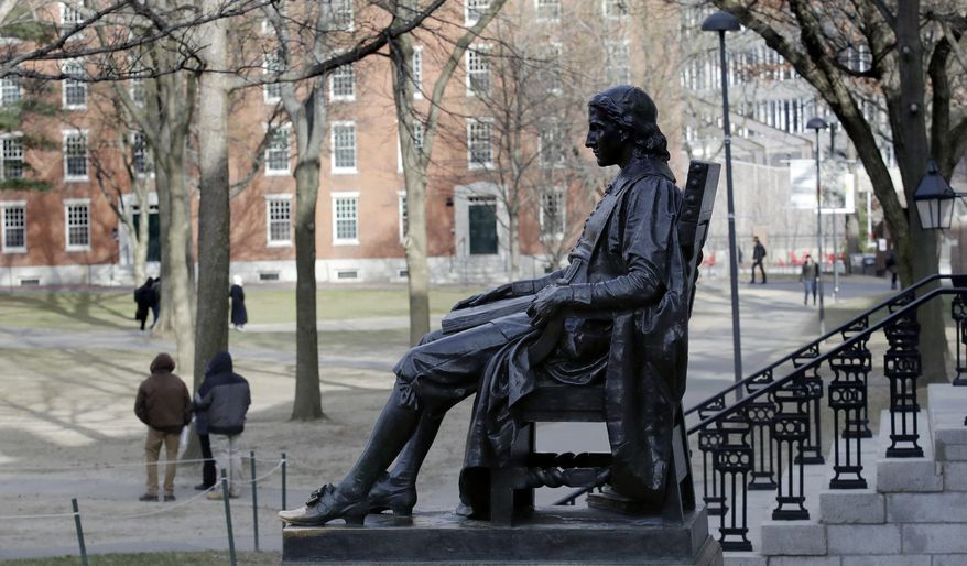 FILE - In this Dec. 13, 2018 file photo, the John Harvard statue looks over Harvard Yard at Harvard University in Cambridge, Mass. A final round of arguments is scheduled for Wednesday, Feb. 13, 2019, in federal court in Boston in a trial alleging racial bias in the university's admissions system. (AP Photo/Charles Krupa, File)