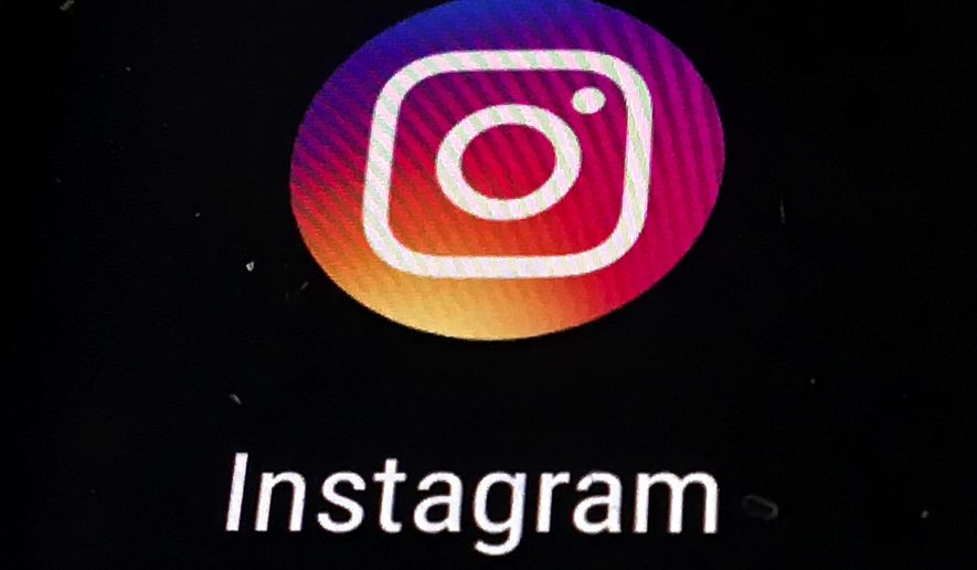 In this Thursday, Nov. 29, 2018, file photo, the Instagram app logo is displayed on a mobile screen in Los Angeles. (AP Photo/Damian Dovarganes, File) **FILE**