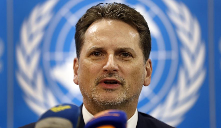 Pierre Krahenbuh, the head of the UN agency for Palestinian refugees, gives a press conference, in Beirut, Lebanon, Wednesday, Feb. 13, 2019. Krahenbuh said the organization was able to keep all schools and health centers in camps around Lebanon last year despite funding cuts. (AP Photo/Hussein Malla)