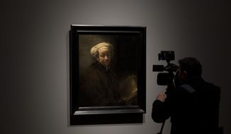 "A cameraman takes images of Rembrandt's ""self-portrait as the Apostle Paul"" (oil on canvas, 1661) during a press preview of an exhibition of the all the Rijksmuseum's Rembrandts in Amsterdam, Netherlands, Wednesday, Feb. 13, 2019. To mark the 350th anniversary of the Dutch master's death, museums across the Netherlands have declared 2019 Rembrandt and the Golden Age Year and are staging a string of exhibitions to highlight their collections. (AP Photo/Peter Dejong)"