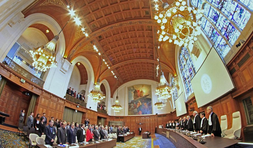 Judges enter as the delegations of Iran, front row left, and the U.S., front row rear right, stand up, at the International Court of Justice, or World Court, in The Hague, Netherlands, Wednesday, Feb. 13, 2019. The court is scheduled to deliver its judgement on U.S. objections about the court's jurisdiction in the case. (AP Photo/Peter Dejong). (AP Photo/Peter Dejong)