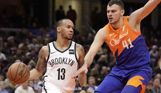 Brooklyn Nets' Shabazz Napier (13) drives past Cleveland Cavaliers' Ante Zizic (41), from Croatia, in the first half of an NBA basketball game, Wednesday, Feb. 13, 2019, in Cleveland. (AP Photo/Tony Dejak)