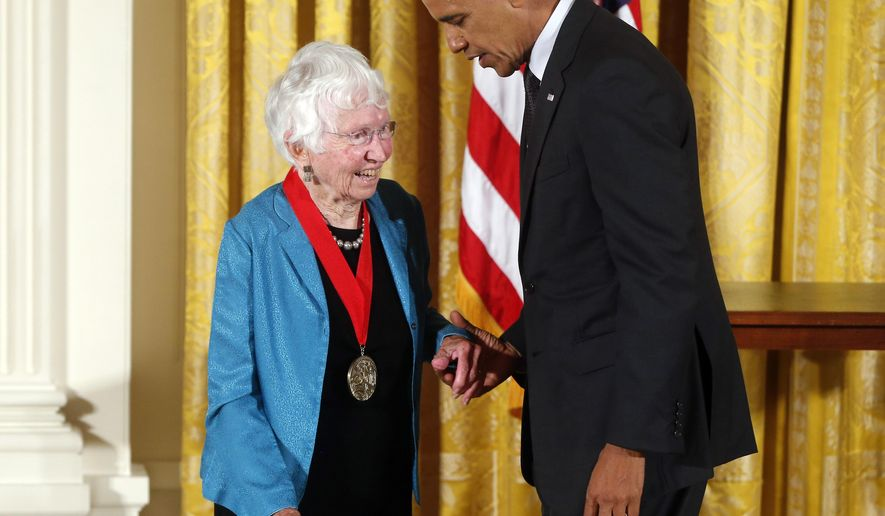 """FILE - In this July 28, 2014 file photo President Barack Obama awards the 2013 National Humanities Medal to historian Anne Firor Scott from Chapel Hill, N.C., during a ceremony in the East Room at the White House in Washington. Anne Firor Scott, a prize-winning historian and esteemed professor who upended the male-dominated field of Southern scholarship by pioneering the study of Southern women, has died. She was 97. Her death was announced last week by Duke University, where she taught for three decades. The citation for her humanities medal praised her """"groundbreaking research spanning ideology, race, and class."""" (AP Photo/Charles Dharapak, file)"""