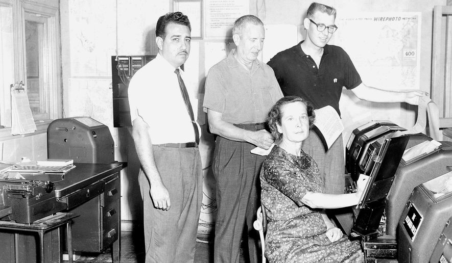 This October 1962 image shows the Associated Press staff in San Antonio, Texas in the bureau. Staffers from left to right are Mechanic-Operator Gilbert Baldarrama, Field Maintenance Man Aubrey Keel, Operator Alicia Keel, and Correspondent Chuck Green. On Tuesday, Feb. 12, 2019, Green, a former Associated Press foreign correspondent and chief of bureau, died. He was 82. (AP Photo)