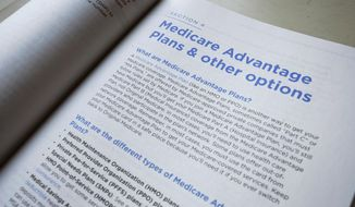This Thursday, Nov. 8, 2018, file photo shows a page from the 2019 U.S. Medicare Handbook in Washington. Medicare Advantage enrollees get a new, second chance to find the right health coverage for 2019. The government added another enrollment window that started Jan. 1 and lasts until March 31. (AP Photo/Pablo Martinez Monsivais)
