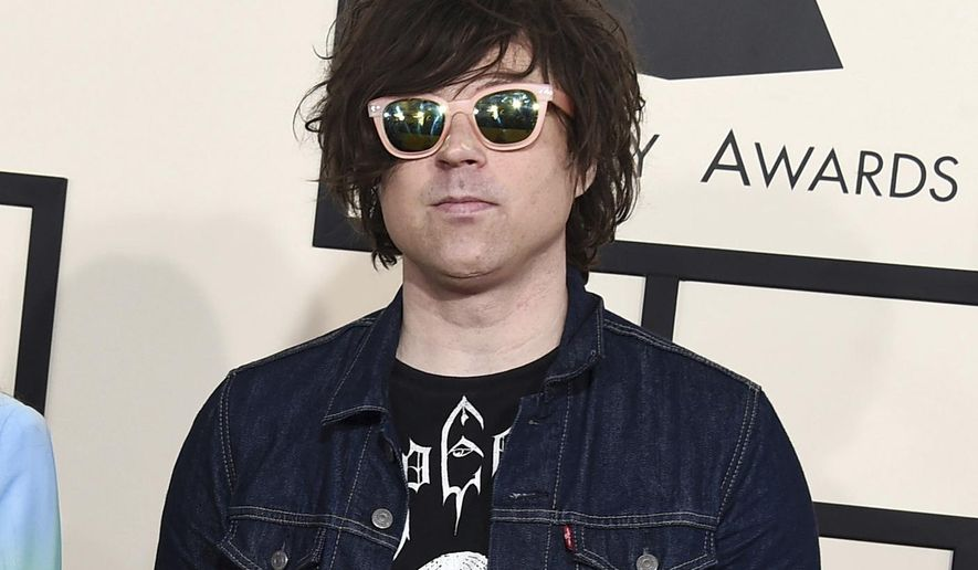 FILE - In this Feb. 8, 2015 file photo, Ryan Adams arrives at the 57th annual Grammy Awards in Los Angeles. A New York Times report says seven women have claimed singer-songwriter Ryan Adams offered to help them with their music careers but then turned things sexual, and he sometimes became emotional and verbally abusive. In the story published Wednesday, Feb. 13, 2019, a 20-year-old female musician said Adams, 44, had inappropriate conversations with her while she was 15 and 16. (Photo by Jordan Strauss/Invision/AP, FIle)