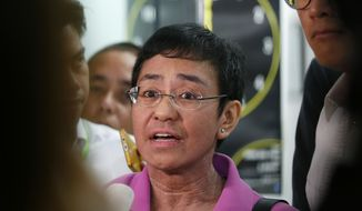"""In this Jan. 22, 2018, file photo, Maria Ressa, CEO of the online news agency Rappler, talks to the media after attending the summons by the National Bureau of Investigation on the cyber libel complaint filed against Rappler five years ago in Manila, Philippines. Philippine authorities have arrested Ressa, Wednesday, Feb. 13, 2019, over a libel complaint that Amnesty International has condemned as """"brazenly politically motivated."""" (AP Photo/Bullit Marquez, File)"""